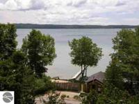 Beautiful sandy beach lot with insulated boathouse,
