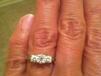 1 Carat Round 3 Stone Diamond Ring. Retails for $2300.