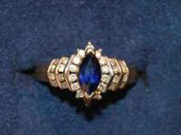 This is genuine mined sapphire surrounded by 0.75 ct