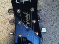 BLACK EPIPHONE ELECTRIC GUITAR. Guitar is still in