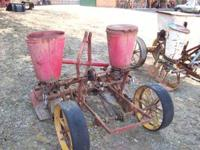 2 row Massey Rusty But works good ,several different