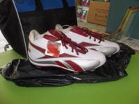 1 Pair of burdunday & white NFL football cleets. Size