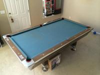 I'm offering my Fischer billiards pool table. Its a