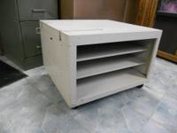 I have for sale one rolling cabinet with two shelves.
