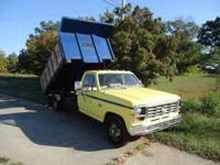 1989 Yellow Ford Diesel Dump Truck 12 Foot Bed, Works