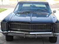 I HAVE A 1965 BUICK RIVIERA FOR SALE 99% RESTORED. I AM