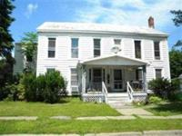 Enjoy steady income from this delightful 4-family on a