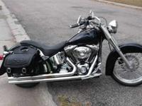 2004 SOFTAIL FATBOY FUEL INJECTED. MANY CUSTOM ADD ONS,
