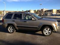 I am selling a Jeep Grand Cherokee Laredo V6 Laredo.