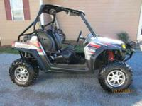 UP FOR SELL IS A 2009 LIQUID SILVER LE POLARIS RANGER