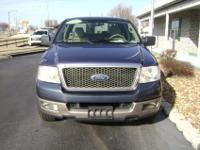 This Blue Ford F150 Ext Cab Lariat 2WD has only 93k