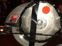 "Gently Used 10"" Skilsaw with 2 Blades(1 wood & 1 Tile)"