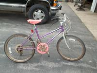 "10 speed Huffy girl's bike. Purple and pink. 24"" tires."