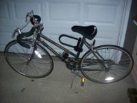 Schwinn World Sport 10-speed bicycle.  Includes a lock