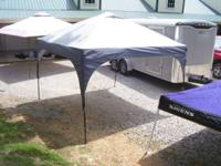 Coleman 10' X 10' instant up canopy . Has built in LED