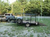 10 x 6 utility trailer with 6 foot high rail sides,