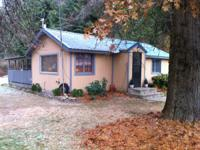 This cozy 2 bedroom cabin style house just a few miles