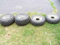 I have for sale 4 used Titan atv tires with rims. Both
