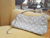 Made in Italy. It's rear bag in Polka dot satin witch