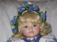 Baby Alexis is a porcelain Marie Osmond doll in the