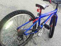"Seling one 24"" mointain bike. It's a nice metal blue"