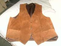 I have a like new 100% Brown Leather Vest size Large,