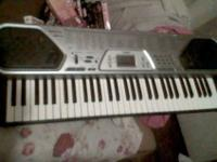 CASIO ELECTRIC KEYBOARD. RUNS ON AIR CONDITIONING