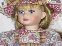 Stitchin' Stacey is a Marie Osmond porcelain doll,