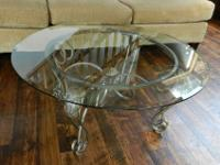 This nice glass & iron coffee table will be a great