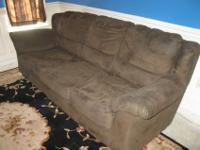 6 year old dark green microfiber couch. This couch has