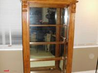 Solid oak curio cabinet, mirrored back and lighted