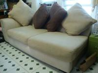 Its a used large couch. It is brown and cream color, it