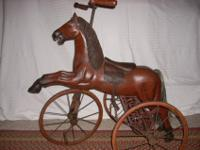 This is a very nice reproduction horse tricycle I have