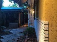 This is a 2/1 duplex at the heart of Coconut Grove.
