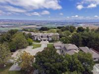 This gorgeous 50 acre 18,000 sq. ft. estate overlooks
