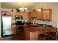 Immaculate & sunfilled 2 BR, 2 BA 3rd floor condo with