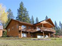 BEAUTIFUL custom cedar-sided home on 20 acres
