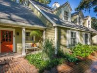 Lovingly renovated 4-5 BR/3.5BA home is surrounded by