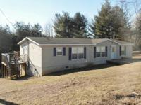 Lovely Doublewide on approx 1 acre. Rural establishing