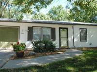 Move-in ready ranch home for sale. Close to K-10 on a