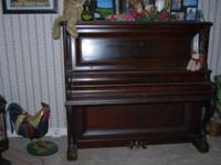 105 year old Behr Grand Upright Piano for sale. Asking