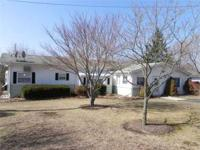 WELL MAINTAINED HOME has newer roof & windows with a