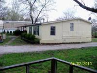 1980 Champion 24ft X 60 ft, 4 beds, 2 baths. Home
