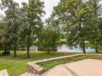 Experience serenity in this beautiful Lake-Front home
