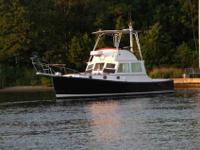 MUST SELL Fly bridge crusier with three steering