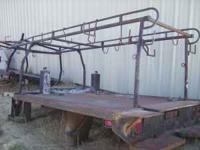 10 Ft Flatbed with lumber rack please call for more
