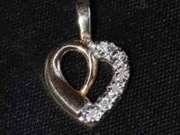 REAL WEIGHT 1.2 grams STONES: 6 HIGH QUALITY DIAMONDS