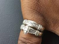 Center set is 3 stones with accents and band has accent