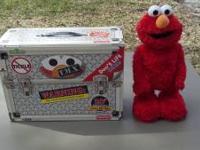 10th Anniversary Tickle Me Elmo in original box. Very