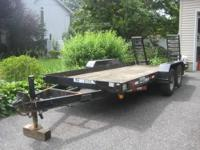 10x5 utility trailer with ramps located in Greenlawn
